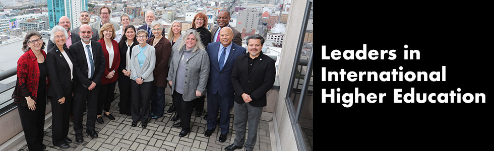 2019 AIEA Board photo on balcony overlooking San Francisco; Text: Leaders in International Higher Education